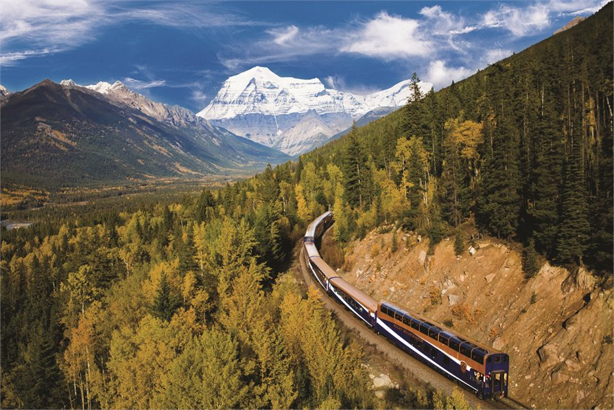 Rocky Mountaineer train passing through the mountains