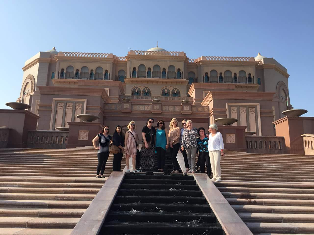 standing outside the Emirates Palace
