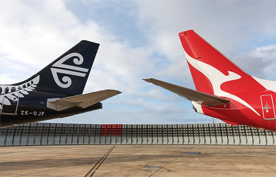 Tails of an Air New Zealand and Qantas planes