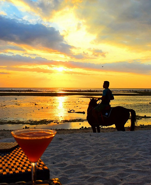 Man on Horseback with the sun setting in the Gili  Islands