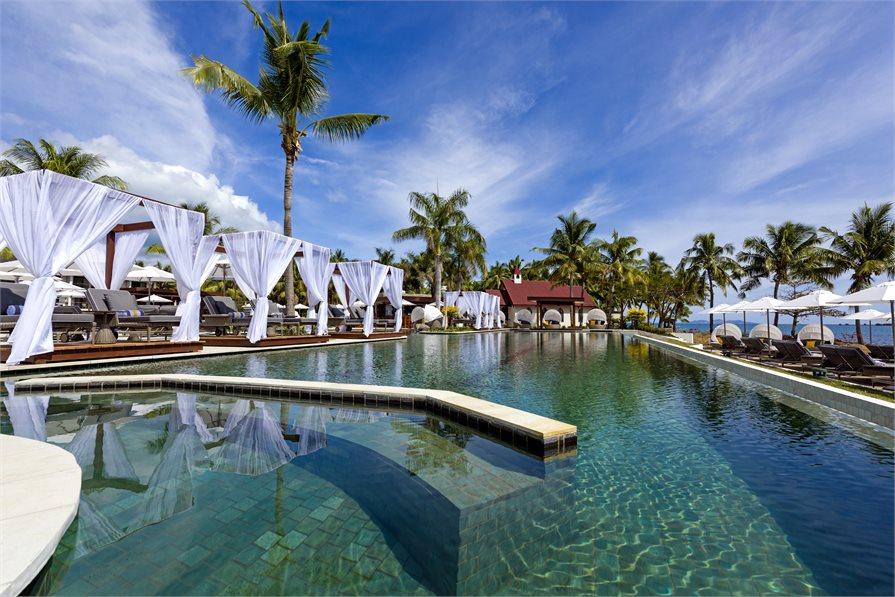 Pool side loungers at Waitui Beach Club