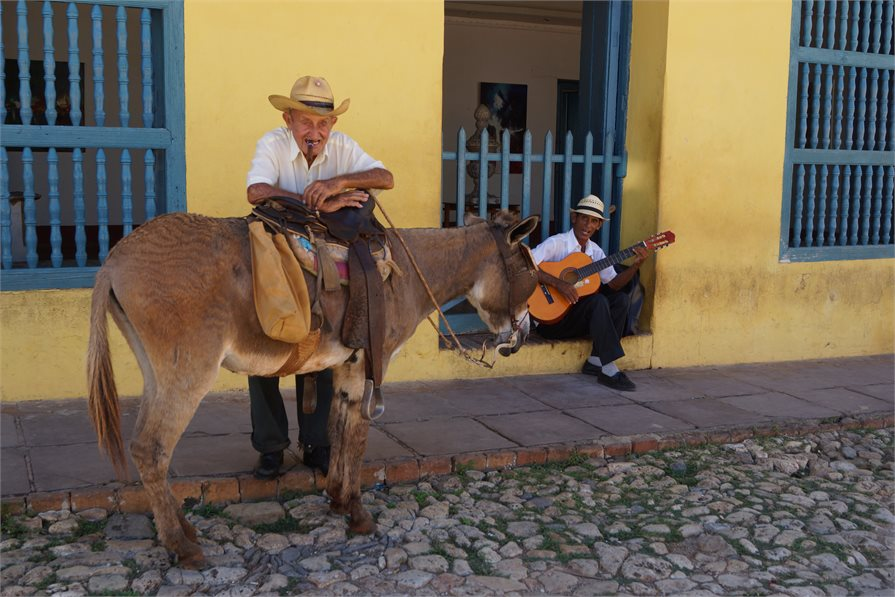 local cuban men with donkey and guitar