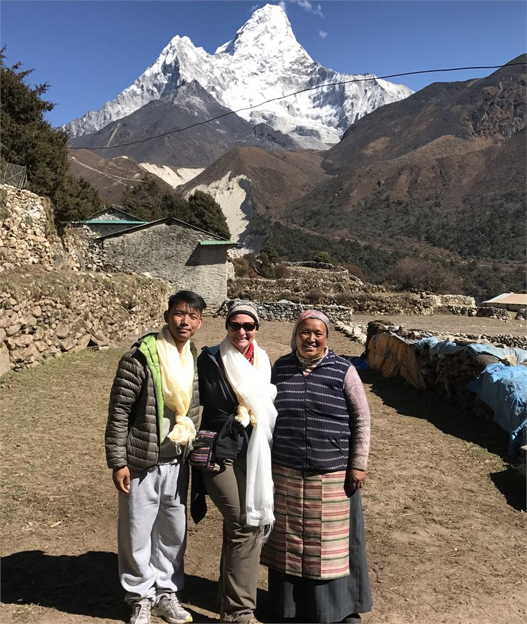 Standing with locals below Mount Everest