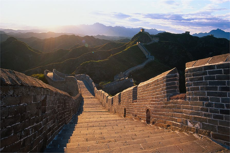 view of the great wall of china at sunset