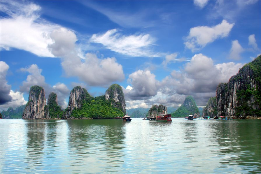 Ha Long Bay boats and mountains