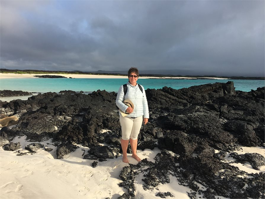 Carolyn Hedley standing on the beach Galapagos Islands