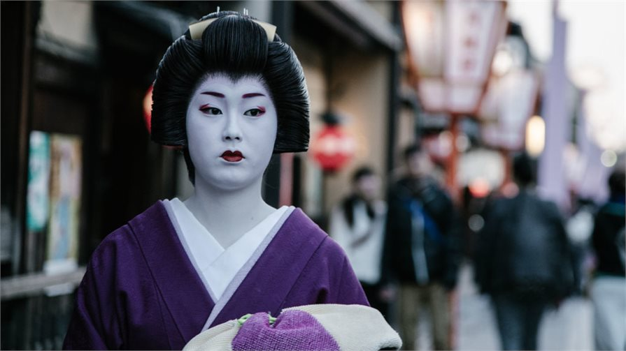 Geisha walking through the street