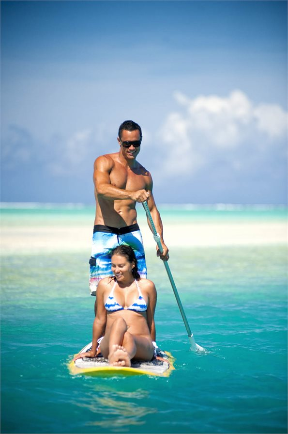 Man and woman on a paddle board