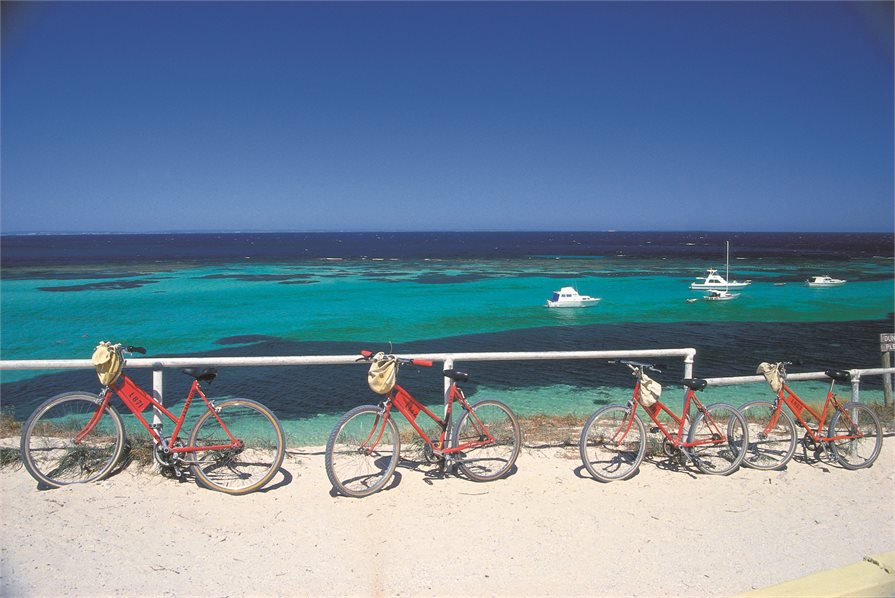 Red bicycles on hand rail Rottnest Island