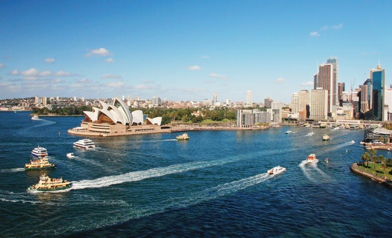 View of Sydney Opera house and harbor with boats